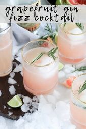 Grapefruit and gin fizz cocktail with rosemary garnish